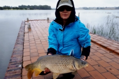 A big carp makes fishing in the rain worthwhile